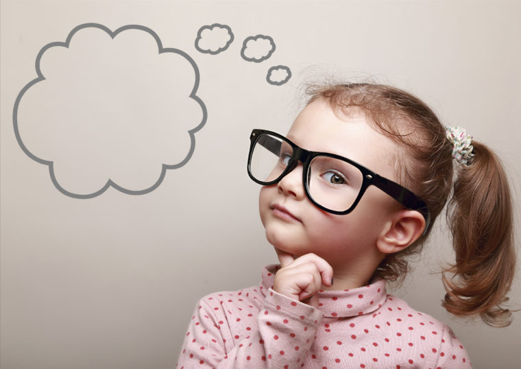 Cute thinking kid girl in glasses with Questions